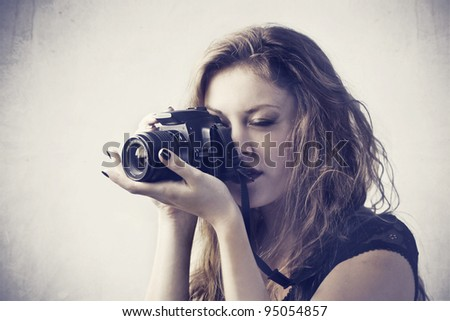 Female photograph holding a camera