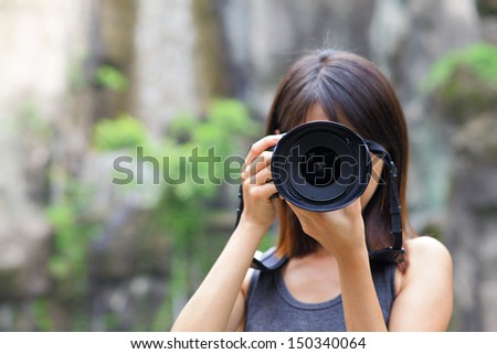 Female photographer - stock photo