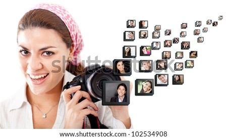 Female photographer holding the camera - isolated over a white background - stock photo