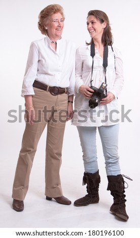 Female photographer posing with senior model