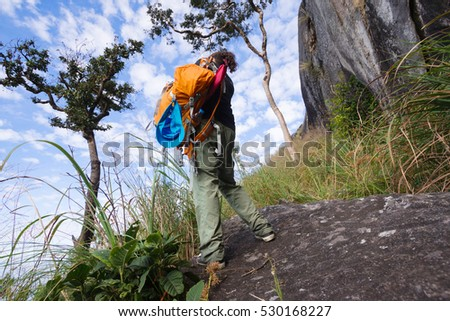 female photographer taking a picture on Mountain