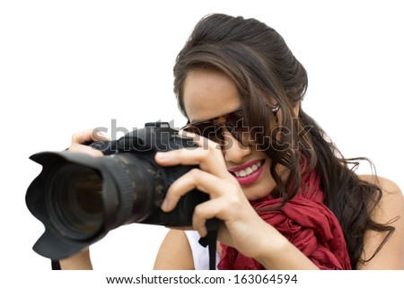 Female photographer taking a picture with camera - stock photo