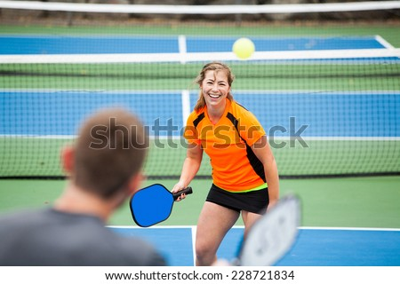 Female Pickleball player on the court.  - stock photo