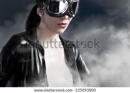 female pilot goggles era aircraft - stock photo
