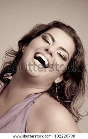 Female Plus size model posing in the studio, duotone face portrait, on grey background. The woman is smiling in a happy manner. Good for concept of health, happiness, dieting, obesity, weight loss. - stock photo