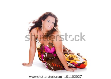 Female Plus size model posing in the studio, full body portrait, on white background. Woman is smiling and sensual on the floor. Good for concept of health, happiness, dieting, obesity, weight loss.