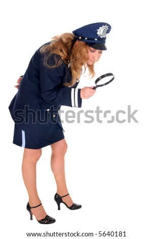 Female police officer investigating crime scene with magnifying glass.