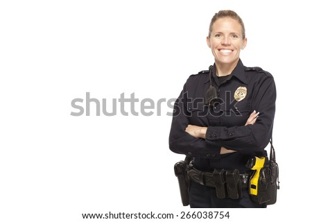 Female police officer posing with arms crossed against white background - stock photo