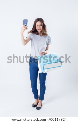 female posing in blue jeans over white background