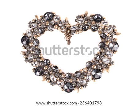 female precious ornaments on a white background in the form of heart - stock photo