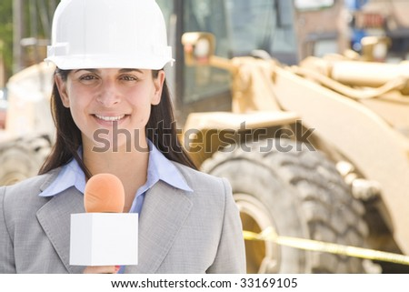 female professional reporting from a construction site