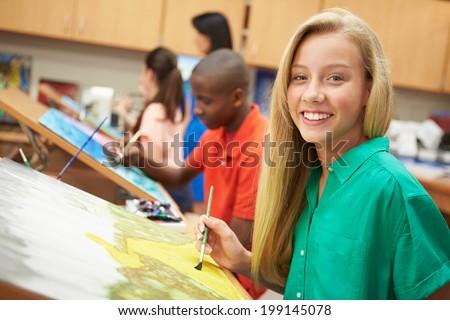 Female Pupil In High School Art Class - stock photo