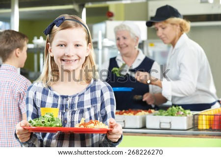 Female Pupil With Healthy Lunch In School Canteen - stock photo