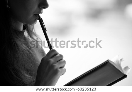 Female reading a book, closeup, background ( black white ) - stock photo