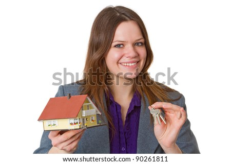 Female real estate agent with keys and model house over white background - stock photo