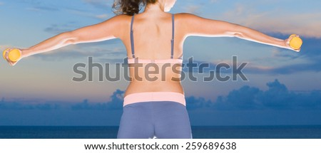 Female rear view - fitness and lifestyle concept - stock photo