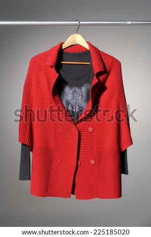 Female red clothing on mannequin isolated-gray background - stock photo