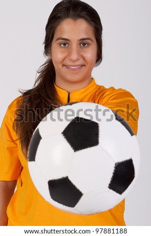 female referee with a soccer ball