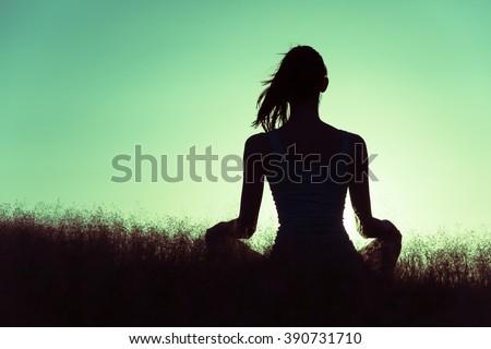 Female relaxing in a open field.  - stock photo