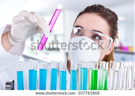 Female researcher with test tubes in laboratory