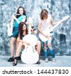 female rock band. girls with musical instruments: guitar, sax and cello - stock photo