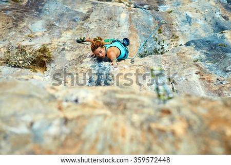 female rock climber  - stock photo