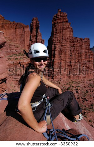 Female rock climber on Ancient Art, fisher Towers, Utah - stock photo
