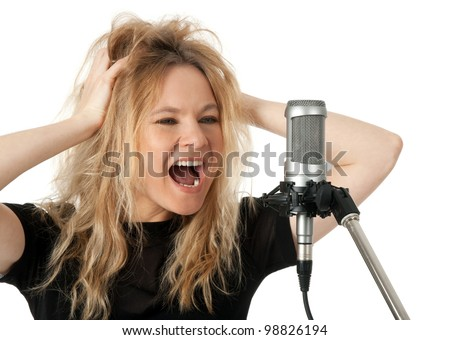 Female rock singer screaming to the microphone. Isolated on white background. - stock photo