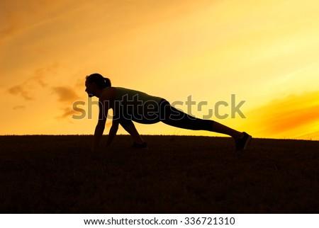 Female runner stretching.  - stock photo
