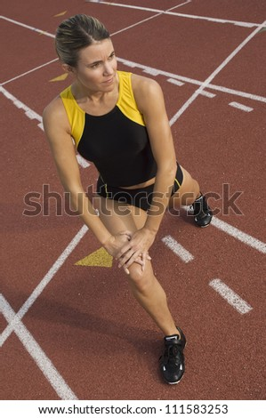 Female runner warming up before starting race