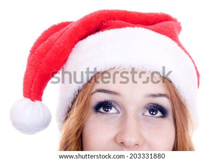 Female santa looking up over a white background.