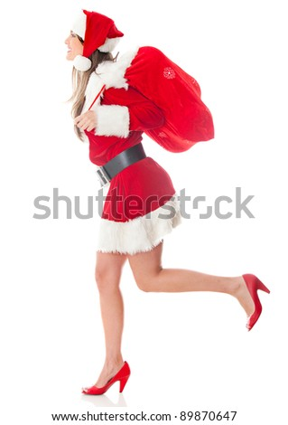 Female Santa running with a gift sack on Christmas day ? isolated - stock photo