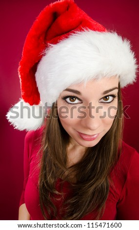 Female santa with red background - stock photo