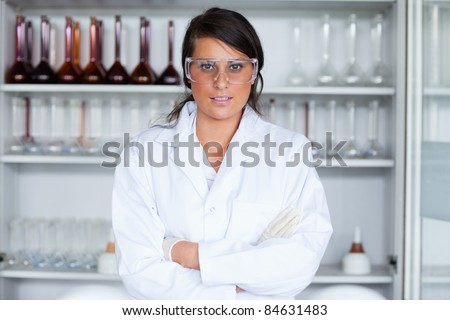Female science student posing in a laboratory