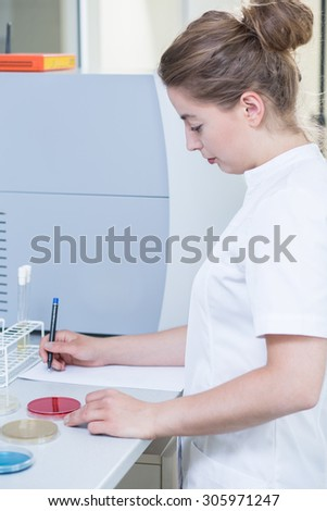 Female scientist doing experiment in research laboratory