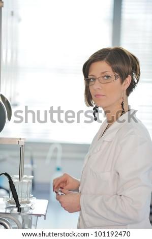 Female scientist in laboratory - stock photo