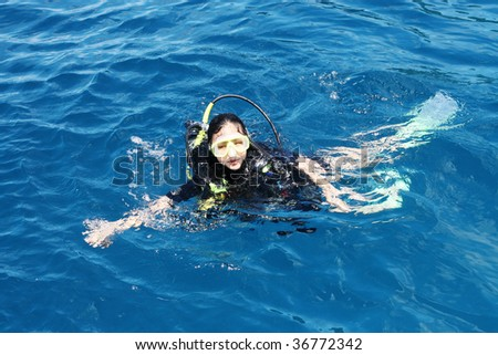 Female scuba diver in the ocean.