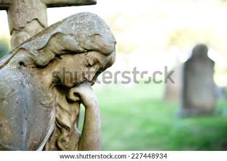 female sculpture on cemetery - stock photo