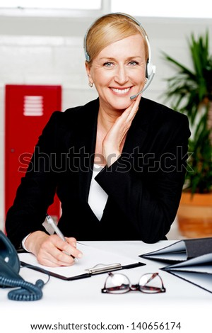 Female secretary confirming appointment with boss - stock photo