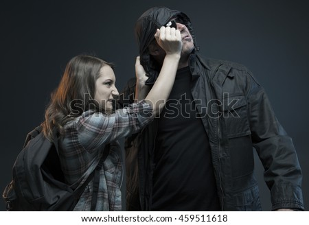FEMALE SELF DEFENSE SERIES- Teenage Girl gets attacked by a stranger and strikes back!Studio photo with filter applied. - stock photo