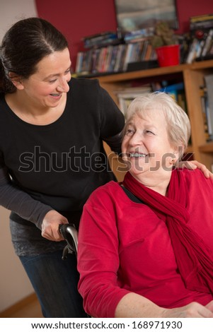female senior in wheelchair at home - stock photo