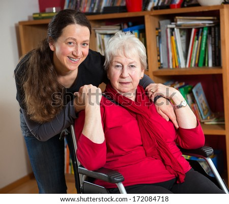 female senior in wheelchair with dependent  - stock photo