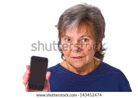 Female senior with her smartphone - isolated on white background - stock photo