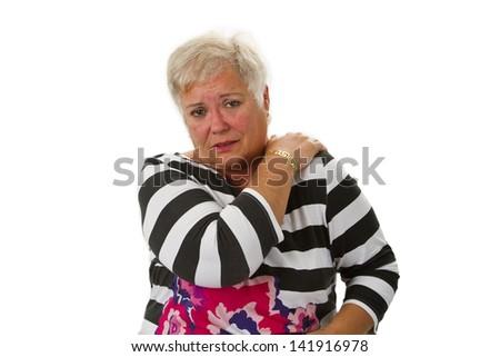 Female senior with neck pain - isolated on white background - stock photo