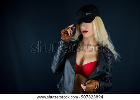 Female sexy breast / Beautiful fashion sexual slim body of woman in studio / Big woman's breasts in black leather jacket / hot sexy blonde girl, mafia glamour bandit gangster mafia style, red lingerie