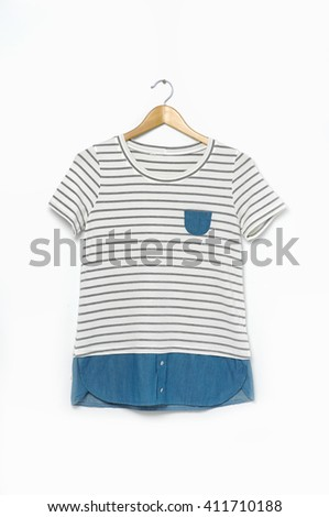 Female shirt on wooden hangers - stock photo