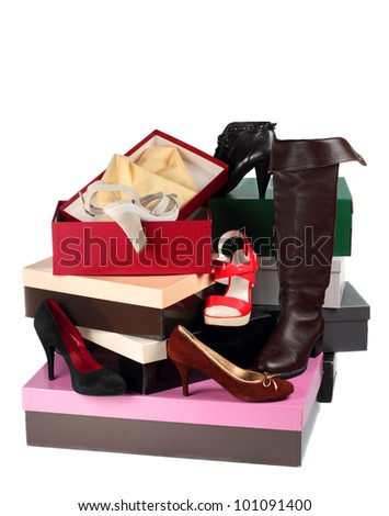 Female shoes and cardboard boxes isolated on white background - stock photo