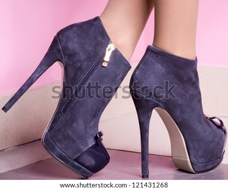 female shoes on a pink background - stock photo