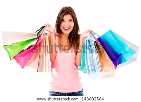 Female shopaholic holding a bunch of shopping bags - isolated over white - stock photo