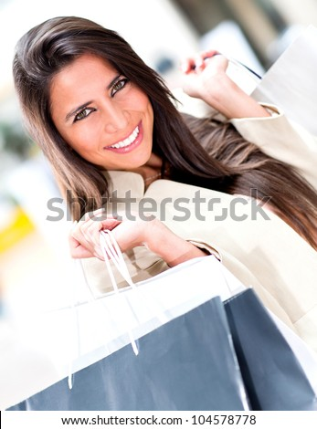 Female shopper holding bags at the shopping center